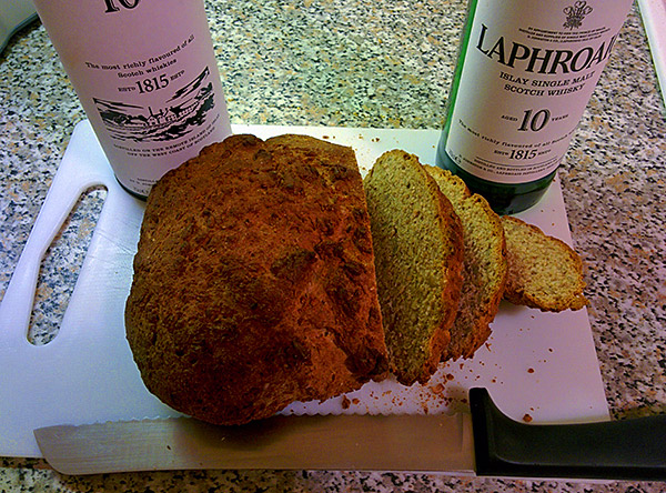 Picture of a cut open bread with a whisky bottle next to it