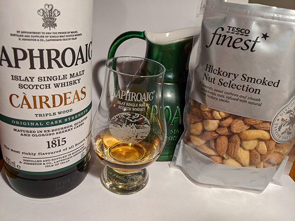 Picture of a Laphroaig Cairdeas Triple Wood with a Hickory Smoked Nut Selection