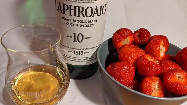Picture of some Scottish strawberries and a glass and bottle of Laphroaig Islay single malt whisky